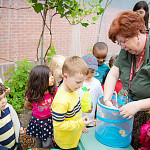 Preschool students in green house